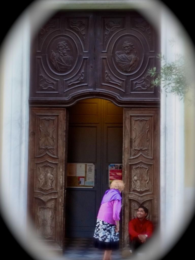 a streetside postcard of a doorway dialogue